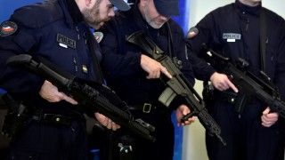 French anti-crime brigade (BAC) officers pose with new German HK G36 assault rifles, during a presentation of the new equipment for the French anti-crime brigade (BAC) of the prefecture of Paris, on February 29, 2016 in Paris, as part of the 2016 BAC-PSIG Plan. / AFP / ALAIN JOCARD