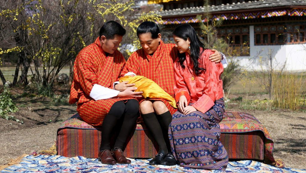 """In this handout photograph released by the Royal Office for Media in Bhutan on February 9, 2016, King Jigme Namgyel Wangchuck (L), his father the former king Jigme Singye Wangchuck, and Queen Jetsun Pema (R) sit with the royal baby Gyalsey at Lingkana Palace in Bhutan.  AFP PHOTO/ROYAL OFFICE FOR MEDIA ---EDITORS NOTE--- RESTRICTED TO EDITORIAL USE - MANDATORY CREDIT """"AFP PHOTO / ROYAL OFFICE FOR MEDIA """" - NO MARKETING NO ADVERTISING CAMPAIGNS - DISTRIBUTED AS A SERVICE TO CLIENTS / AFP / ROYAL OFFICE FOR MEDIA / ROYAL OFFICE FOR MEDIA"""