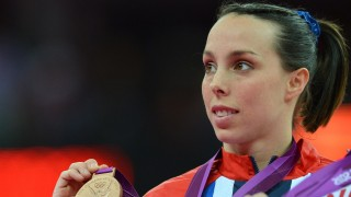 Bronze medalist Britain's Beth Tweddle celebrates on the podium of the women's uneven bars of the artistic gymnastics event of the London Olympic Games on August 6, 2012 at the 02 North Greenwich Arena in London.  Russia's gymnast Aliya Mustafina won gold, China's He Kexin took silver and got bronze.  AFP PHOTO / BEN STANSALL / AFP / BEN STANSALL