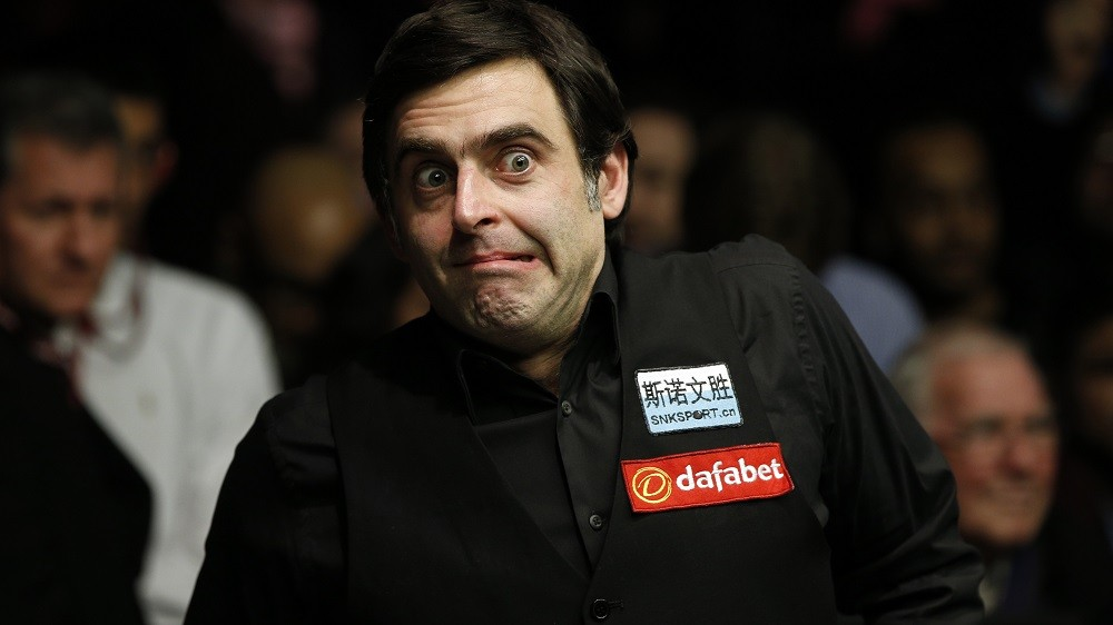 England's Ronnie O'Sullivan reacts after winning the frame to win the match and beat England's Barry Hawkins (not pictured) in the Masters Snooker final at Alexandra Palace in north London on January 17, 2016. O'Sullivan overwhelmed Barry Hawkins 10-1 to win the final of the Masters snooker tournament at London's Alexandra Palace.  AFP PHOTO / ADRIAN DENNIS / AFP / ADRIAN DENNIS