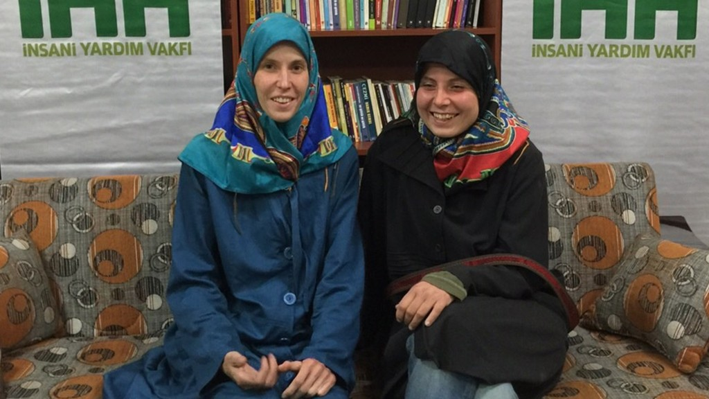 """A handout picture taken March 27, 2015 and released on March 28, 2015 by the IHH (The Foundation for Human Rights and Freedom and Humanitarian Relief) shows two Czech women Antonie Chrastecka (L) and Hana Humpalova (R) posing after being rescued in Van, eastern Turkey, on March 27, 2015. Two young Czech women kidnapped in Pakistan in 2013 have been freed and have returned home, Prime Minister Bohuslav Sobotka said on March 28. He added that the two 26-year-old women were freed with the help of the Turkish Muslim humanitarian organisation IHH.  AFP PHOTO / IHH RESTRICTED TO EDITORIAL USE MANDATORY CREDIT """"AFP PHOTO / IHH"""" - NO MARKETING NO ADVERTISING CAMPAIGNS - DISTRIBUTED AS A SERVICE TO CLIENTS / AFP / IHH / -"""