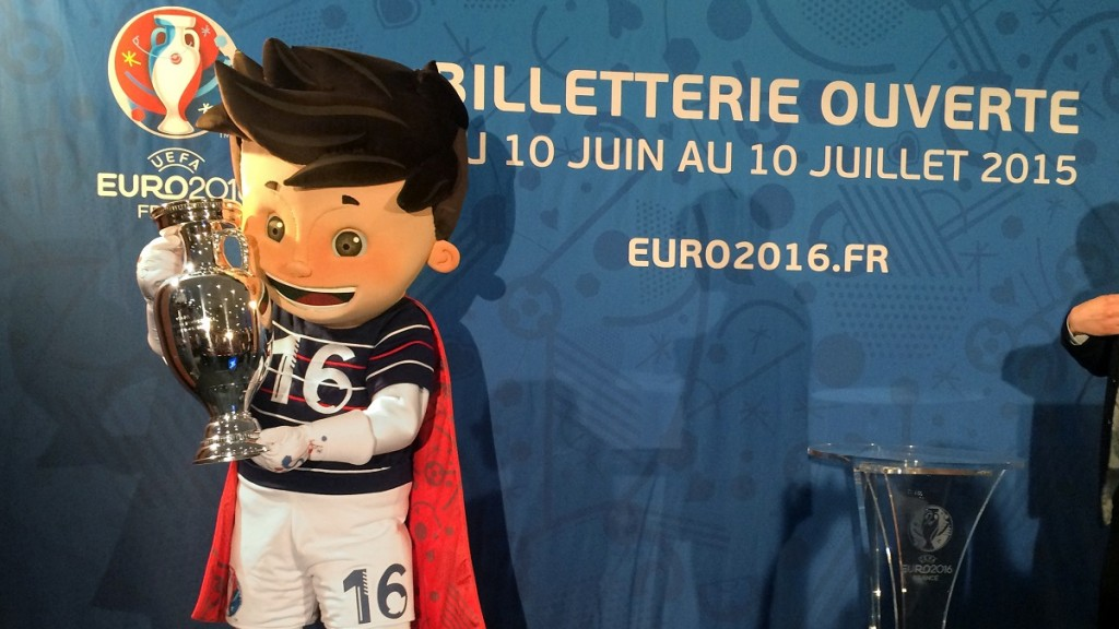 Mascot 'Super Victor' holds a replica of the European Championship Cup in his hands during a presentation to promote tickets for the UEFAEURO2016, which will be made available to the public starting today, in Paris, France, 12 May 2015. During the initial phase from 10 June to 10 July 2015, one million tickets for the 51 games will be be sold exclusively online (euro2016.tickets.uefa.com). Successful applicants will be determined through a random selection process. PHOTO:GERDROTH/dpa