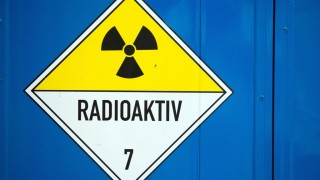 A warning sign reads 'Radioactive' on a container at the interim nuclear waste storage facility in Lubmin,Germany, 25 November 2015. According to its operator Energiewerke Nord (EWN), the facility currently runs at 75 per cent of its storage capacity. Photo: JENSBUETTNER/dpa