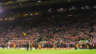 A general view of the Kop where no flags or banners have been permitted as fans sing ahead of the UEFA Europa League Group B football match between Liverpool FC and FC Girondins de Bordeaux on 26th November 2015 played at Anfield in Liverpool, England. Photo Paul Greenwood / Backpage Images / DPPI