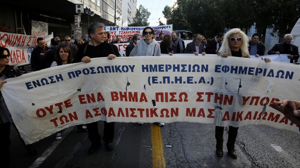 ATHENS, GREECE - FEBRUARY 3: Greek journalists gather in front of Ministry of Labor as they go on a general strike set to disrupt services across the country to protest pension reforms that are part of the country's third international bailout in Athens, Greece on February 3, 2016. 