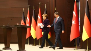 ANKARA, TURKEY - FEBRUARY 8: Prime Minister of Turkey Ahmet Davutoglu (R) and German Chancellor Angela Merkel (L) prepare to hold a joint press conference following their meeting in Ankara, Turkey on February 8, 2016. Hakan Goktepe / Anadolu Agency