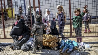 ALEPPO, SYRIA - FEBRUARY 08: Syrians who flee the attacks of Syrian and Russian air forces, shelter at tents and try to live their lives with humanitarian aid send by Turkey, at the Bab al-Salameh border crossing on Turkish-Syrian border near Azaz town of Aleppo, Syria on February 08, 2016. Fatih Aktas / Anadolu Agency