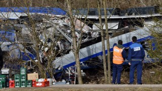 """MUNICH, GERMANY - FEBRUARY 09: Workers of a railway company called """"Meridian"""" are seen on duty at the two trains' collision site after two commuter trains collied on a route, close to Bad Aibling, approximately 60 kilometers (40 miles) southeast of Munich, Germany on February 09, 2016. At least 8 killed and several others injured after the collision, reported. Lukas Barth / Anadolu Agency"""