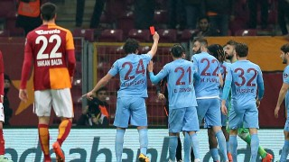 ISTANBUL, TURKEY, FEBRUARY 21: Salih Dursun (24) of Trabzonspor shows a red card to referee as he takes the card from referee's hand  to react his decisions during Turkish Spor Toto Super Lig football match between Galatasaray and Trabzon at Turk Telekom Arena in Istanbul, Turkey on February 21, 2016. Berk Ozkan / Anadolu Agency