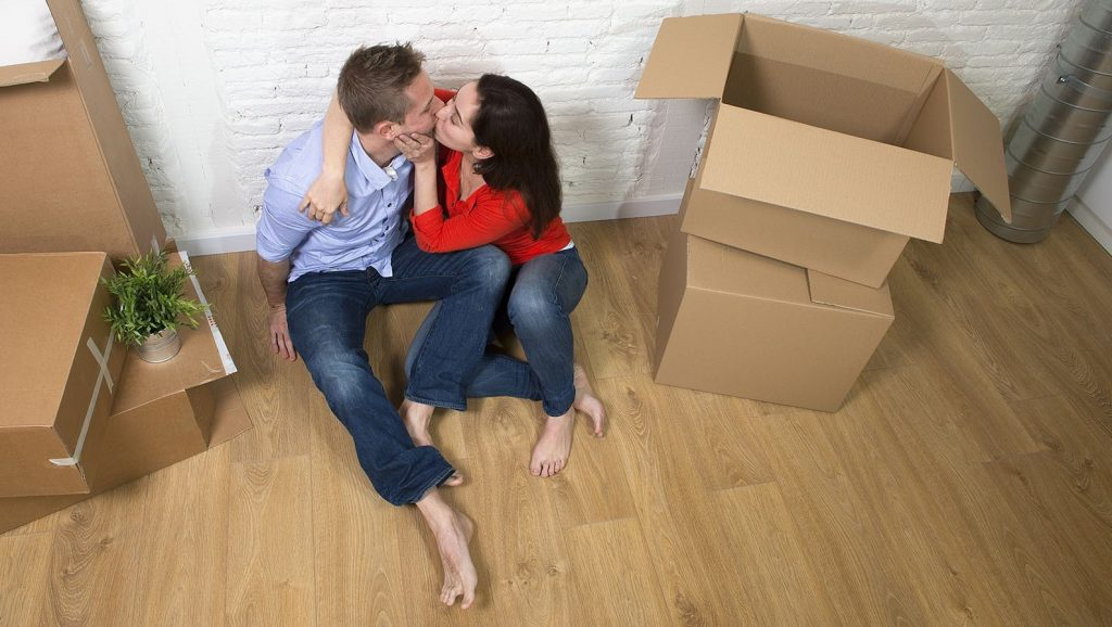 young happy couple celebrating moving in new house