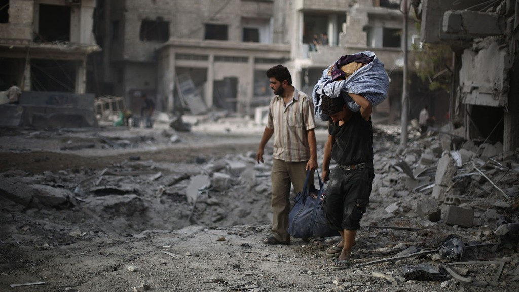 DAMASCUS, SYRIA - SEPTEMBER 11: People are seen after Assad regime forces' air-strike staged to residential areas, in Douma District of East Ghouta region of Damascus, Syria on September 11, 2015. Casualties reported after the air-strike. (Photo by Mohammed Badra/Anadolu Agency/Getty Images)