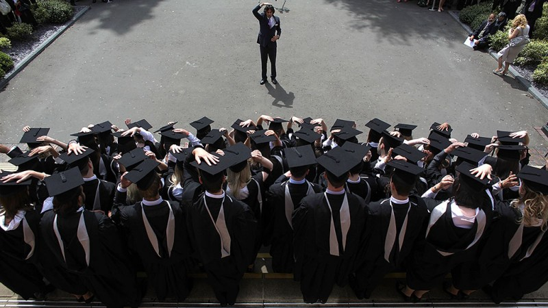 BIRMINGHAM, ENGLAND - JULY 14:  The photographer instructs students to adjust their mortartboards at the University of Birmingham as they graduate on July 14, 2009 in Birmingham, England. Over 5000 graduates will be donning their robes this week to collect their degrees from The University of Birmingham. A recent survey suggested that there are 48 graduates competing for every job.  (Photo by Christopher Furlong/Getty Images)