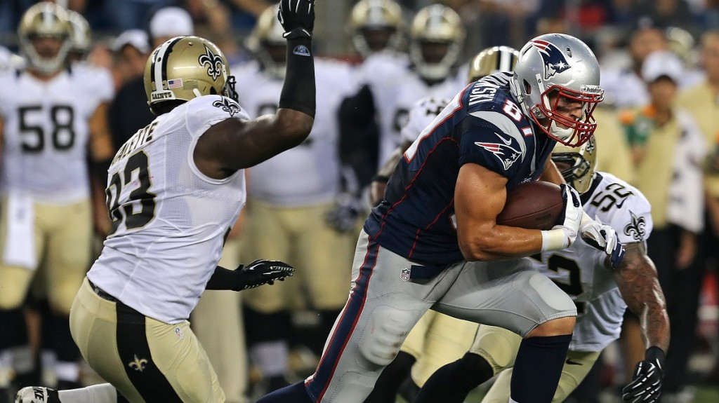 FOXBOROUGH, MA - AUGUST 9: New England Patriots tight end Rob Gronkowski (#87) looks for some running room after a reception during the first quarter of a preseason exhibition game against the New Orleans Saints at Gillette Stadium. (Photo by Barry Chin/The Boston Globe via Getty Images)