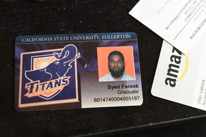 The California State University Fullerton student identification of San Bernardino mass murder suspect Syed Farook sits on a desk inside Farook's home, December 4, 2015 in Redlands, California. The community is mourning as police continue to investigate a mass shooting at the Inland Regional Center in San Bernardino that left at least 14 people dead and another 21 injured.  AFP PHOTO / ROBYN BECK / AFP / ROBYN BECK