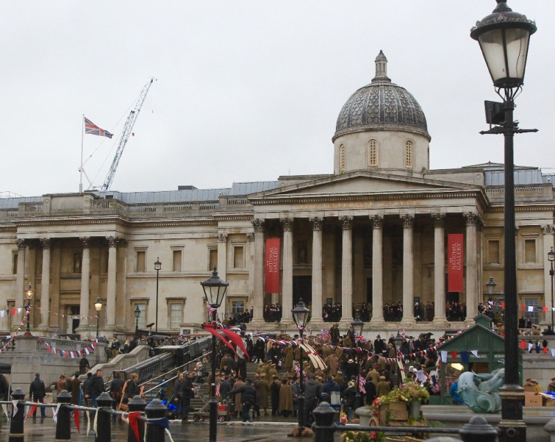 Central London roads are closed for five hours by the movie 'Wonder Woman' filming in Trafalgar Square. The scene is the The Armistice of 11 November 1918, when war ended. Gal Gadot (Wonder Woman) jokes on set with Lucy Davis.  Featuring: Atmosphere Where: London, United Kingdom When: 21 Feb 2016 Credit: David Sims/WENN.com