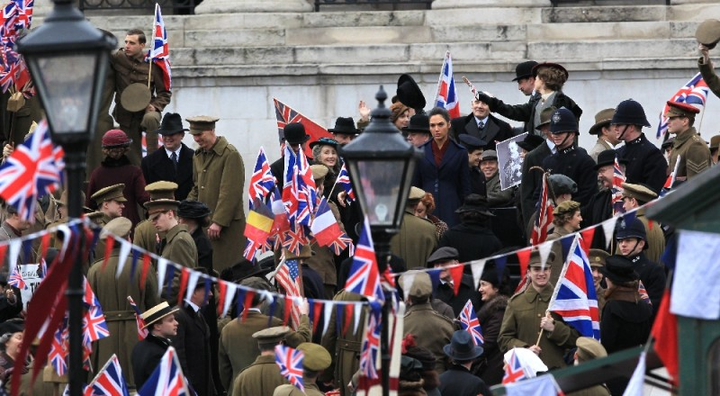 Central London roads are closed for five hours by the movie 'Wonder Woman' filming in Trafalgar Square. The scene is the The Armistice of 11 November 1918, when war ended. Gal Gadot (Wonder Woman) jokes on set with Lucy Davis.  Featuring: Gal Gadot Where: London, United Kingdom When: 21 Feb 2016 Credit: David Sims/WENN.com