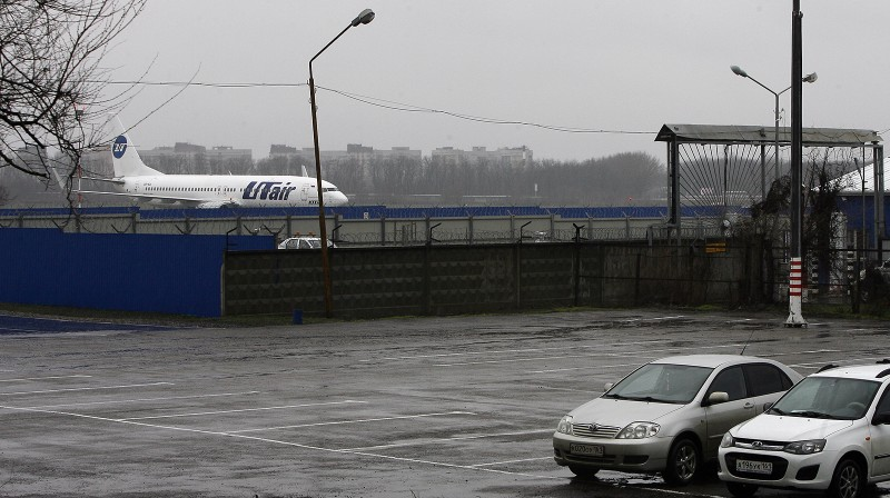 An airplane from Russian airline UTair Aviation is parked at the airfield of the airport in Rostov-on-Don on March 19, 2016. All sixty-two people on board a flydubai Boeing 737 were killed when the plane crashed and burst into flames as it was landing in Rostov-on-Don, in Southern Russia, on Saturday morning, officials said. The plane was making its second attempt to land in bad weather when it missed the runway, erupting in a huge fireball as it crashed and leaving debris scattered across a wide area. / AFP / SERGEI VENYAVSKY