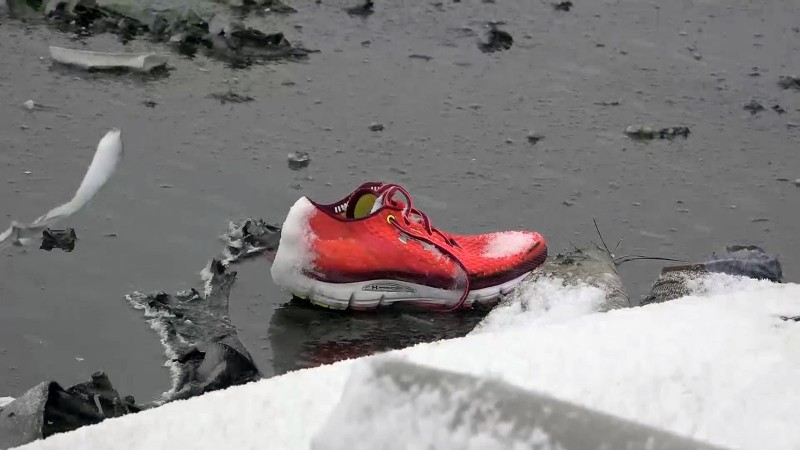 2809776 03/19/2016 A passenger's sneaker on the crash site of the Boeing-737-800 passenger jet which crashed on landing in Rostov-on-Don airport (a video screen shot courtesy of the Russian Emergencies Ministry)./Press-service of Russian Emergency Situations Ministry