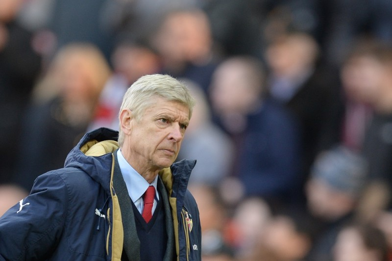 Arsenal's French manager Arsene Wenger leads off his team at the end of the English Premier League football match between Manchester United and Arsenal at Old Trafford in Manchester in north west England on February 28, 2016. / AFP / OLI SCARFF / RESTRICTED TO EDITORIAL USE. No use with unauthorized audio, video, data, fixture lists, club/league logos or 'live' services. Online in-match use limited to 75 images, no video emulation. No use in betting, games or single club/league/player publications.  /