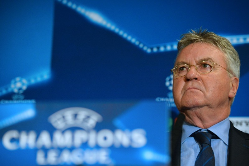 Chelsea's Dutch interim manager Guus Hiddink gestures during a press conference at Stamford Bridge in London on March 8, 2016 ahead of their UEFA Champions League, round of 16 second leg football match against Paris Saint-Germain.    / AFP / GLYN KIRK