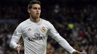 Real Madrid's Colombian midfielder James Rodriguez celebrates after scoring during the UEFA Champions League round of 16, second leg football match Real Madrid FC vs AS Roma at the Santiago Bernabeu stadium in Madrid on March 8, 2016. / AFP / GERARD JULIEN