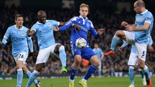 Dynamo Kiev's Polish forward Lukasz Teodorczyk (2R) vies with Manchester City's Argentinian defender Pablo Zabaleta (R), Manchester City's French defender Eliaquim Mangala (2R), and Manchester City's Argentinian defender Martin Demichelis during a UEFA Champions League last 16, second leg football match between Manchester City and Dynamo Kiev at the Etihad Stadium in Manchester, north west England, on March 15, 2016. / AFP / OLI SCARFF