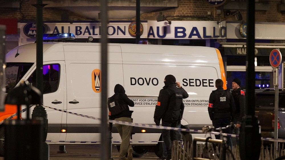 A Belgian Army Mine Clearance Department vehicle is seen on the Place Saint-Denis - Sint-Denijsplein near the site of a shooting in the rue du Dries-Driesstraat in Forest-Vorst, Brussels, on early March 16, 2016. Belgian and French police launched a vast manhunt for suspects late March 15 after a Kalashnikov-wielding assailant was killed and four officers were wounded during an anti-terror operation in Brussels linked to the Paris attacks. The dead person had not been identified but prosecutors said it was not Salah Abdeslam, a key suspect in the November 13 killings in Paris claimed by the Islamic State jihadist group, which killed 130 people. / AFP / Belga / Nicolas Maeterlinck 0032475310634 / Belgium OUT