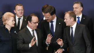 Lithuanian Prime minister Dalia Grybauskaite, French President of Republic Francois Hollande talks with Dutch Prime minister Mark Rutte and EU Council President Donald Tusk and Hungary Prime minister Viktor Orban (BackR)  during the European Union summit in Brussels on March 17, 2016, where 28 EU leaders will discuss the ongoing refugee crisis.  / AFP / JOHN THYS