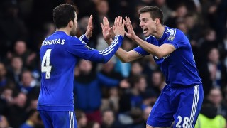 Chelsea's Spanish midfielder Cesc Fabregas (L) celebrates with Chelsea's Spanish defender Cesar Azpilicueta after scoring his penalty during the English Premier League football match between Chelsea and West Ham United at Stamford Bridge in London on March 19, 2016. The game finished 2-2. / AFP / Ben STANSALL / RESTRICTED TO EDITORIAL USE. No use with unauthorized audio, video, data, fixture lists, club/league logos or 'live' services. Online in-match use limited to 75 images, no video emulation. No use in betting, games or single club/league/player publications.  /