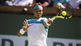 Rafael Nadal returns the ball to Novak Djokovic of Serbia  in the men's semifinals March 19, 2016, at the BNP Paribas Open at the Indian Wells Tennis Garden in Indian Wells, California. / AFP / ROBYN BECK