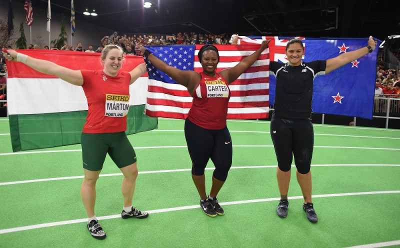 Gold medallist the USA's Michelle Carter (C), silver medallist Hungary's Anita Marton (L), and bronze medallist New Zealand's Valerie Adams pose for photos after the Shot Put final at the IAAF World Indoor athletic championships in Portland, Oregon on March 19, 2016. / AFP / DON EMMERT
