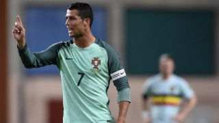 Portugal's forward Cristiano Ronaldo gestures during the friendly football match between Portugal and Belgium at Magalhaes Pessoa stadium in Leiria, Portugal on March 29, 2016. / AFP / FRANCISCO LEONG