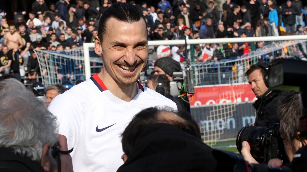 Paris Saint-Germain's Swedish forward Zlatan Ibrahimovic reacts after PSG defeated Troyes in their French Ligue 1 football match on March 13, 2016 at the Aube Stadium in Troyes. Paris Saint-Germain clinched a fourth consecutive Ligue 1 title in record time on March 13 after defeating Troyes, obliterating a new French record for the quickest league victory with eight games to spare before the end of the L1 championships. PHOTO AFP / FRANCOIS NASCIMBENI / AFP / FRANCOIS NASCIMBENI