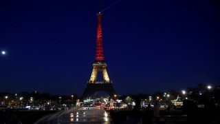 A picture taken on March 22, 2016 shows the Eiffel Tower in Paris illuminated in colours of the Belgian flag in tribute to the victims of terrorist attacks in Brussels. Around 35 people were killed and more than 200 wounded in a series of attacks in Brussels today claimed by the Islamic State group and described as a strike at the very heart of Europe.  AFP PHOTO / LIONEL BONAVENTURE / AFP / LIONEL BONAVENTURE