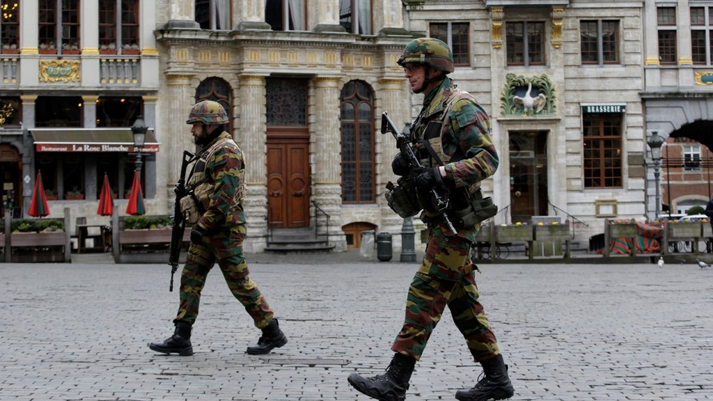 Soldiers patrol in central Brussels on March 23, 2016, a day after triple bomb attacks in the Belgian capital killed about 35 people and left more than 200 people wounded. A series of explosions claimed by the Islamic State group ripped through Brussels airport and a metro train on March 22, killing around 35 people in the latest attacks to bring bloody carnage to the heart of Europe.  AFP PHOTO / KENZO TRIBOUILLARD / AFP / KENZO TRIBOUILLARD