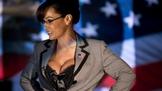 Lisa Ann, an adult film star and Sarah Palin tribute artist, gets up after speaking to members of the press at Thee DollHouse gentleman's club on August 25, 2012 in Tampa, Florida. Lisa Ann was booked to perform a strip show dressed to look like former Alaska Governor and 2008 Republican vice presidential candidate Sarah Palin at Thee DollHouse in preparation for the 2012 Republican Convention.     AFP PHOTO/Brendan SMIALOWSKI / AFP / BRENDAN SMIALOWSKI
