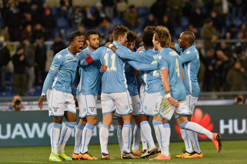 ITALY, Rome: SS Lazio players celebrate around Miroslav Klose (C) during the Italian Serie A football match between S.S. Lazio and A.C. Atalanta at the Olympic Stadium in Rome, on March 13, 2016. - CITIZENSIDE/silvia loré