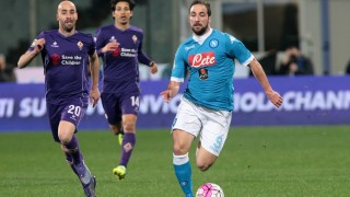Napoli's player Higuain vies with Fiorentina's player BorjaValero during the Italian Serie A football match between ACF Fiorentina and Napoli Calcio at Artemio Franchi Stadium in Florence on February 29, 2016. PH. CONTROLUCE/ PIETRO MOSCA