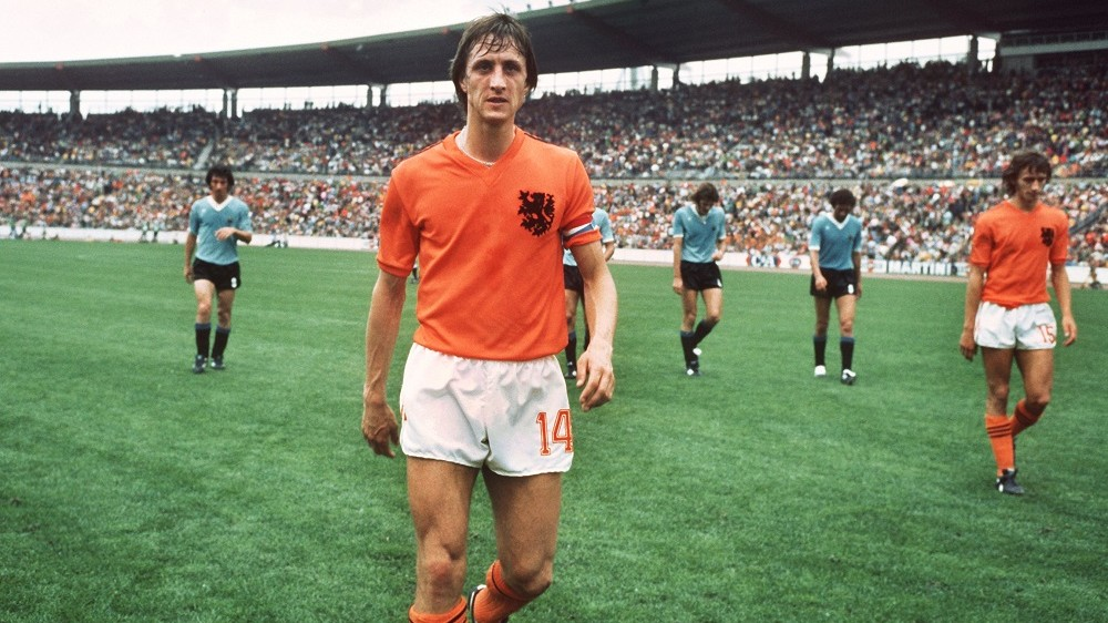 Team captain of the Dutch national football team Johan Cruyff (C), is leaving the pitch after winning the 1974 FIFA World Cup preliminary round match (group III) 2:0 against Ururguay on June 15th.