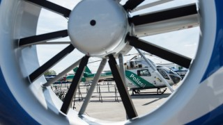 A view of a McDonnell Douglas MD 902 Explorer police helicopter through a rudder fan of the the Airbus helicopter H145 in the context of the event '50 years of Police Helicopter Squadron Baden-Wuerttemberg' in Stuttgart, Germany, 26 July 2015. Photo:DANIELMAURER/dpa