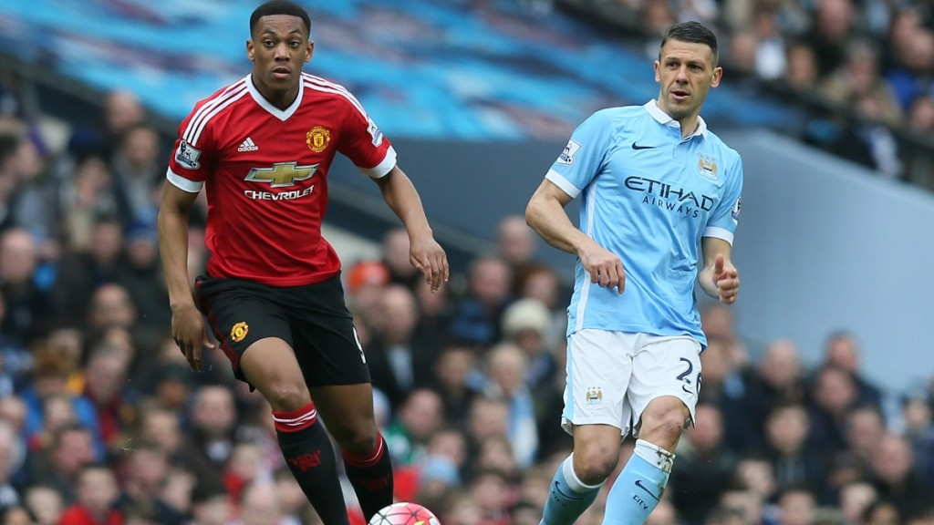 Martin Demichelis of Manchester City and Manchester United's Anthony Martial during the English championship Premier League football match between Manchester City and Manchester United on March 20, 2016 played at the Etihad Stadium in Manchester, England - Photo Paul Currie / Backpage Images / DPPI