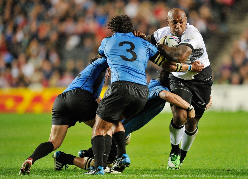 Nemani Nadolo of Fiji is tackled by Mario Sagario (3), Juan Manuel Gaminara and Alejandro Nieto of Uruguay during the IRB Rugby World Cup 2015 Pool A rugby union match between Fiji and Uruguay on October 6, 2015 played at Stadium MK in Milton Keynes, Great Britain. Photo Joe Toth / Backpage Images / DPPI