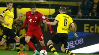 DORTMUND, GERMANY - MARCH 5: Sven Bender (R) in action against Robert Lewandowski (L) of Bayern Munich during Bundesliga soccer match between Borussia Dortmund and Bayern Munich at the Signal-Iduna stadium in Dortmund, Germany on March 5, 2016. Ina Fassbender / Anadolu Agency