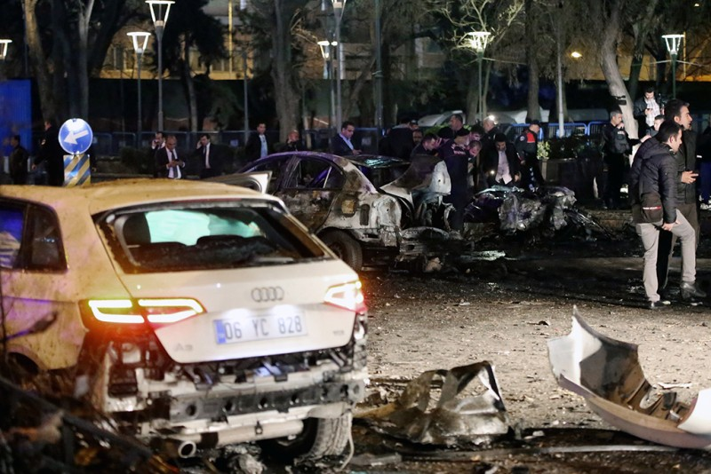 This picture taken on March 13, 2016, shows burnt out cars after a blast in Ankara.