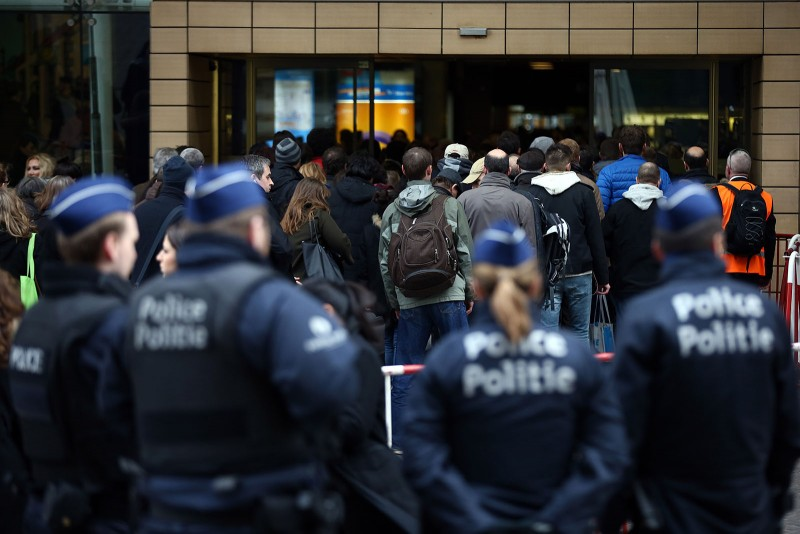 BRUSSELS, BELGIUM - MARCH 23: Police officers look on as people enter Brussels Midi train station on March 23, 2016 in Brussels, Belgium. Belgium is observing three days of national mourning after 34 people were killed in a twin suicide blast at Zaventem Airport and a further bomb attack at Maelbeek Metro Station. Two brothers are thought to have carried out the airport attack and an international manhunt is underway for a third suspect. The attacks come just days after a key suspect in the Paris attacks, Salah Abdeslam, was captured in Brussels.  (Photo by Carl Court/Getty Images)
