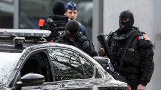 Security forces secure the streets, in Brussels, Belgium, 22 March 2016. According to media reports, 34 people have been killed and around 230 injured in a series of terrorist attacks on 22 March 2016 in Brussels. PHOTO: FEDERICO GAMBARINI/DPA
