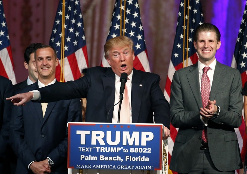 (FILES) This file photo taken on March 15, 2016 shows Republican presidential candidate Donald Trump (C) with his son, Eric (R)and his campaign manager Corey Lewandowski as he addresses the media following victory in the Florida state primary  in West Palm Beach, Florida.  Donald Trump's presidential campaign manager was arrested and charged with battery March 29, 2016 for allegedly grabbing a reporter, Florida police said, in a dramatic new illustration of the tensions surrounding the Republican frontrunner's White House bid. Corey Lewandowski is accused of grabbing reporter Michelle Fields so hard that it left bruises on her arm at a March 8 Trump news conference at a golf club he owns in the Palm Beach County town of Jupiter.  / AFP / RHONA WISE