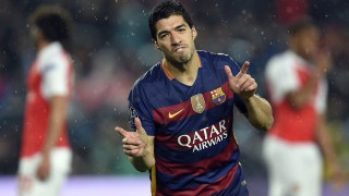 Barcelona's Uruguayan forward Luis Suarez celebrates a goal during the UEFA Champions League Round of 16 second leg football match FC Barcelona vs Arsenal FC at the Camp Nou stadium in Barcelona on March 16, 2016.  / AFP / LLUIS GENE
