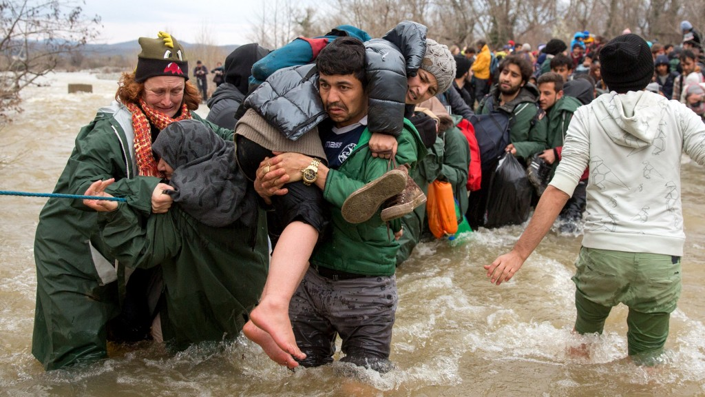 IDOMENI, GREECE - MARCH 14:  Migrants try to cross a river after leaving  the Idomeni refugee camp on March 13, 2016 in Idomeni, Greece. The decision by Macedonia to close its border to migrants on Wednesday has left thousands of people stranded at the Greek transit camp. The closure, following the lead taken by neighbouring countries, has effectively sealed the so-called western Balkan route, the main migration route that has been used by hundreds of thousands of migrants to reach countries in western Europe such as Germany. Humanitarian workers have described the conditions at the camp as desperate, which has been made much worse by recent bouts of heavy rain.  (Photo by Matt Cardy/Getty Images)