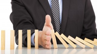 businessman hand stop dominoes continuous toppled